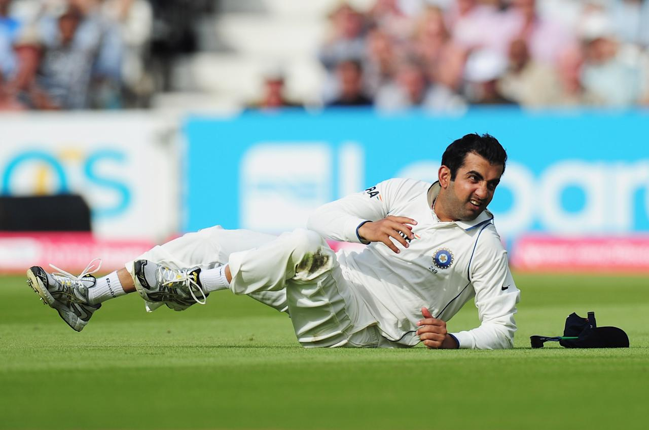 LONDON, ENGLAND - AUGUST 19: Gautam Gambhir of India falls to the ground after dropping a catch to dismiss Kevin Pietersen of England during day two of the 4th npower Test Match between England and India at The Kia Oval on August 19, 2011 in London, England.  (Photo by Shaun Botterill/Getty Images)
