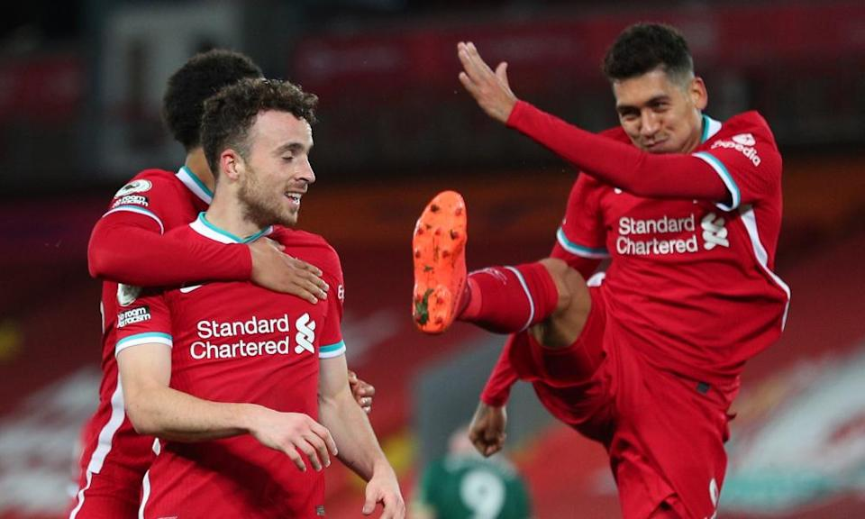 Diogo Jota celebrates with Roberto Firmino and Trent Alexander-Arnold after scoring Liverpool's winner.