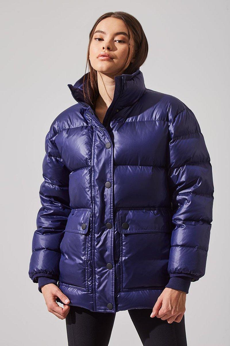 Traveler Down Filled Recycled Polyester Cargo Parka. Image via MPG Sport.
