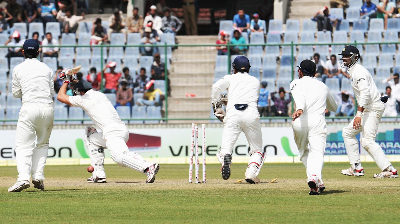 Mitchell Johnson bold out by Ravichandran Ashwin of India during the 4th test match of Border Gavaskar Trophy, at Ferozeshah Kotla Stadium in Delhi on March 22, 2013. P D Photo by P S Kanwar