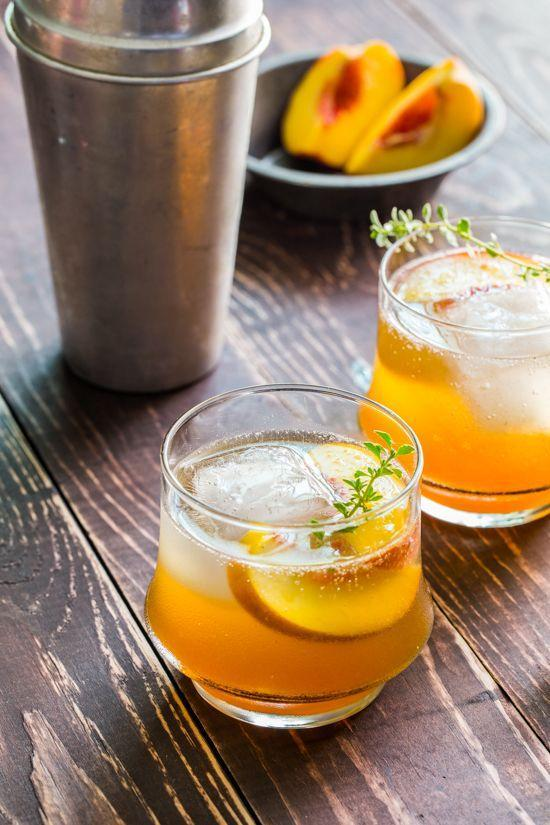 "<p>Roasting the fruit first helps infuse your cocktail with extra peachy sweetness.</p><p>Get the recipe from <a href=""http://jellytoastblog.com/roasted-peach-bourbon-cocktail-cocktail-friday"" rel=""nofollow noopener"" target=""_blank"" data-ylk=""slk:Jelly Toast"" class=""link rapid-noclick-resp"">Jelly Toast</a>.</p>"
