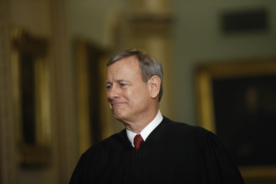 "FILE - In this Jan. 16, 2020, file photo Chief Justice of the United States, John Roberts walks to the Senate chamber at the Capitol in Washington. Roberts told graduating seniors at his son's high school that the coronavirus has ""pierced our illusion of certainty and control"" and counseled them to make their way in a world turned upside down with humility, compassion and courage. (AP Photo/Matt Rourke, File)"