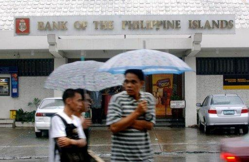 Philippine lender Bank of the Philippine Islands is in talks to acquire local rival Philippine National Bank