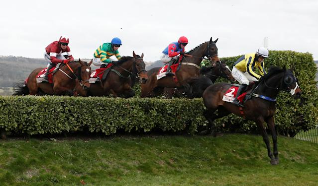 Horse Racing - Cheltenham Festival - Cheltenham Racecourse, Cheltenham, Britain - March 14, 2018 Beeves ridden by Sean Quinlan clears a fence during the 16:10 Glenfarclas Chase (Cross Country Chase) Action Images via Reuters/Matthew Childs