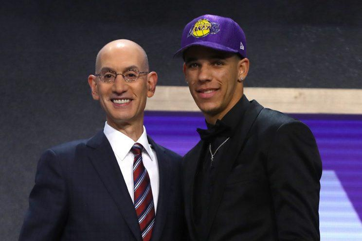 Lonzo Ball poses with NBA commissioner Adam Silver after being drafted by the Lakers. (Getty Images)