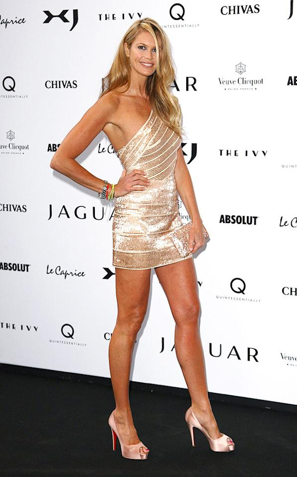 "46-year-old supermodel Elle Macpherson put women half her age to shame in a Herve Leger beaded mini and pink Louboutin platforms while in London to promote the new Jaguar XJ. ""The Body"" has still got it goin' on! Gareth Cattermole/<a href=""http://www.gettyimages.com/"" target=""new"">GettyImages.com</a> - July 9, 2009"