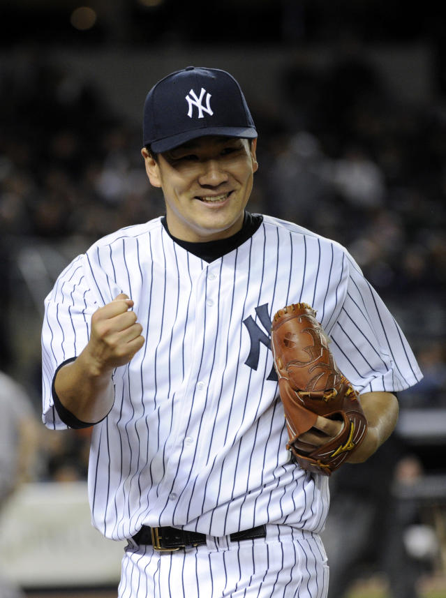 New York Yankees pitcher Masahiro Tanaka reacts after second baseman Brian Roberts made a play to get out Baltimore Orioles' Ryan Flaherty to end the sixth inning of a baseball game Wednesday, April 9, 2014, at Yankee Stadium in New York. (AP Photo/Bill Kostroun)