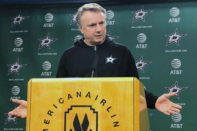 """The Dallas Stars interim coach Rick Bowness speaks during a news conference after the team fired second-year coach Jim Montgomery on Tuesday, Dec. 10, 2019, for what the team called unprofessional conduct. General manager Jim Nill said Montgomery had acted inconsistently with """"core values and beliefs of the Dallas Stars and the National Hockey League."""" He did not elaborate. (AP Photo/Schuyler Dixon)"""