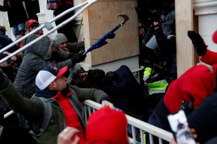 FILE PHOTO: Pro-Trump protesters clash with police during a rally to contest the certification of the 2020 U.S. presidential election results by the U.S. Congress, at the U.S. Capitol Building in Washington
