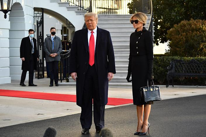 <p>Donald Trump and Melania Trump talk to the press as they depart the White House.</p>