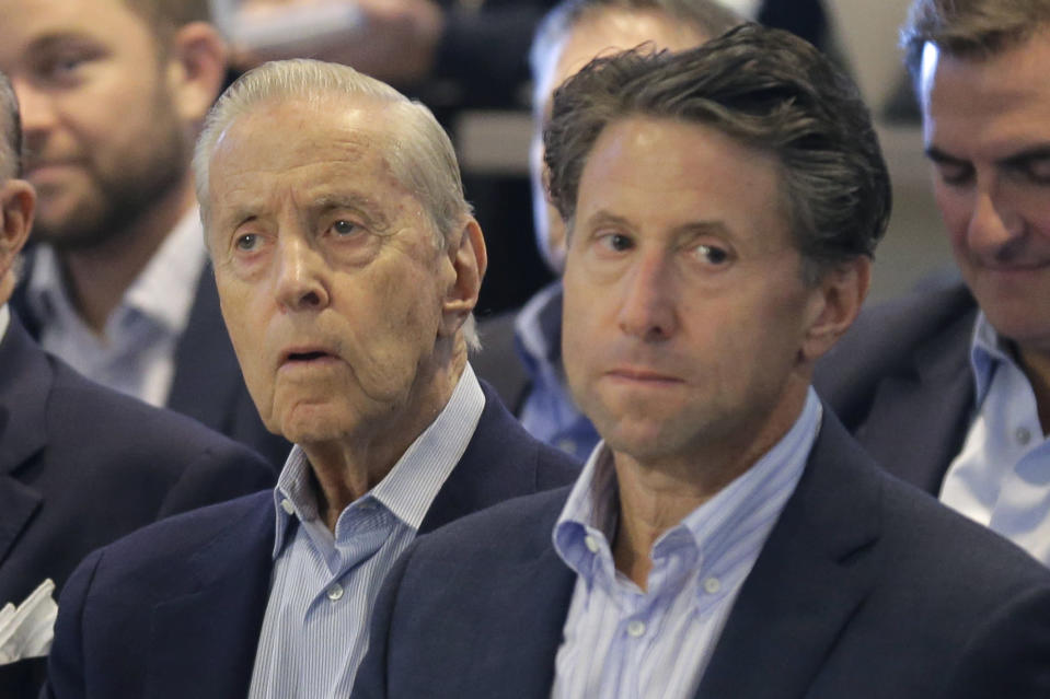 FILE - In this Nov. 4, 2019, file photo, New York Mets owners Fred, left, and Jeff Wilpon attend a baseball news conference at Citi Field in New York. Major League Baseball owners voted Friday, Oct. 30, 2020, to approve the sale of the New York Mets to billionaire hedge fund manager Steve Cohen. The sale from the Wilpon and Katz families values the franchise at between $2.4 billion and $2.45 billion, a record for a baseball team. The sale is likely to close within 10 days. (AP Photo/Seth Wenig, File)