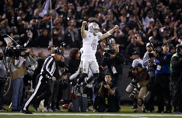 Derek Carr celebrates his defense's game-clinching interception on Thursday night. (Ezra Shaw/Getty Images)