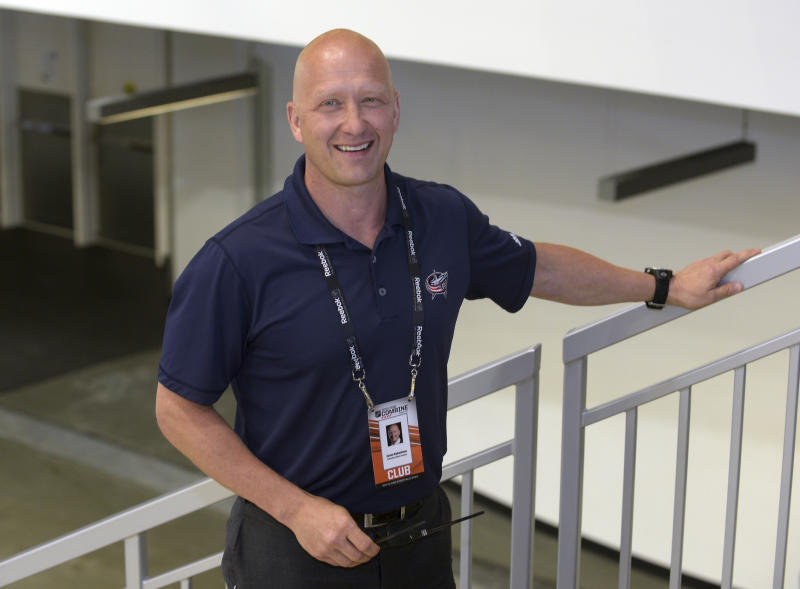 FILE - In this June 6, 2015, file photo, Columbus Blue Jackets general manager Jarmo Kekalainen poses for a photo as he watches NHL draft prospects test during the NHL Combine in Buffalo, N.Y. Where many raise concern, Kekalainen sees only opportunity regarding the uncertain state of the Blue Jackets' roster a week before the NHL's free agency signing period opens. (AP Photo/Gary Wiepert, File)