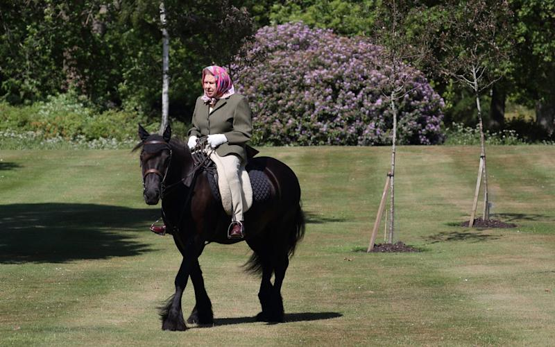 The Queen riding Balmoral Fern, her 14-year-old pony, in Windsor Home Park - PA