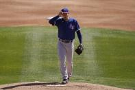 Texas Rangers starting pitcher Kohei Arihara, of Japan, steps on the mound during the first inning of a spring training baseball game against the Chicago White Sox Tuesday, March 2, 2021, in Phoenix. (AP Photo/Ross D. Franklin)