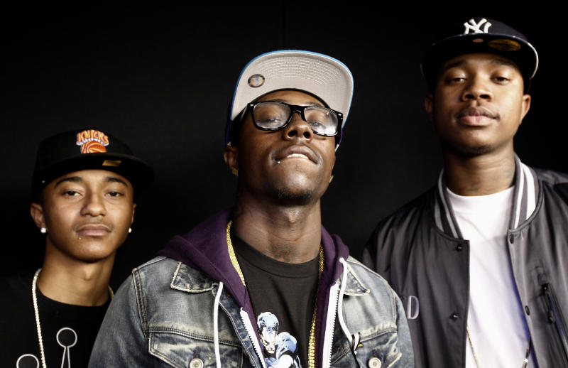 """In this June 2, 2011 photo, Jay Are, left, Yung, center, and C Smoove from the music group Cali Swag District pose for a portrait in Los Angeles. One of the members of the group, Montae Talbert, also  known as """"M-Bone"""", was shot and killed on May 15, 2011. (AP Photo/Matt Sayles)"""
