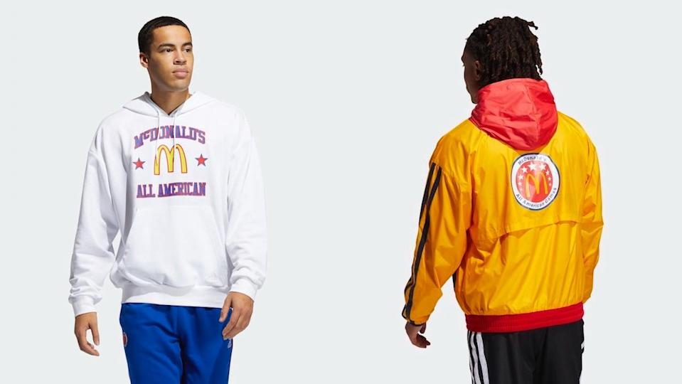 side by side of two men wearing Adidas' McDonald's All American Games apparel, a white hooded sweatshirt and a yellow and red track jacket