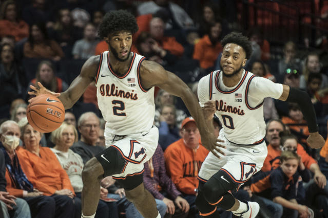 Illinois' Kipper Nichols heads down court with teammate Alan Griffin after stealing the ball in the first half of an NCAA college basketball game against Northwestern, Saturday Jan. 18, 2020, in Champaign, Ill. (AP Photo/Holly Hart)