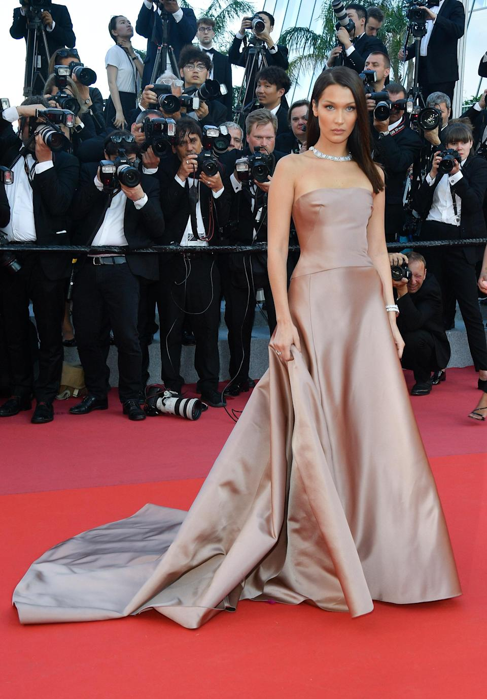 <p>Bella had her very own princess moment at the screening of 'Ash Is The Purest White' wearing a dusty pink custom Dior gown which featured a sleeveless bodice, worn with lots of diamonds. [Photo: Getty] </p>