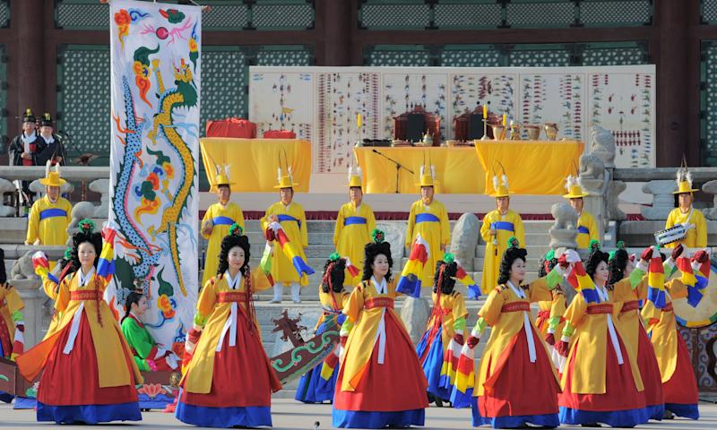 South Koreans attired in royal court costumes dance during a ceremony to welcome the return of priceless ancient royal books at Gyeongbok Palace in Seoul on Saturday June 11, 2011.  South Korea honored the return of nearly 300 royal books looted by French soldiers in the 19th century with the colorful welcome ceremony. (AP Photo/Kim Jae-hwan, Pool)