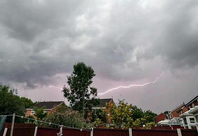 Lightning strikes above Liverpool on Tuesday evening as violent thunderstorms swept across the north of England and Scotland. (PA)