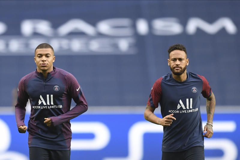 PSG's Neymar, right, and Kylian Mbappe exercise during a training session at the Luz stadium in Lisbon, Tuesday Aug. 11, 2020. PSG will play Atalanta in a Champions League quarterfinals soccer match on Wednesday. (David Ramos/Pool via AP)