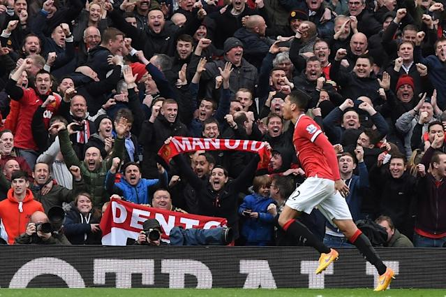 Manchester United's English defender Chris Smalling celebrates after scoring their fourth goal during the English Premier League football match at Old Trafford in Manchester, England, on April 12, 2015 (AFP Photo/Paul Ellis)