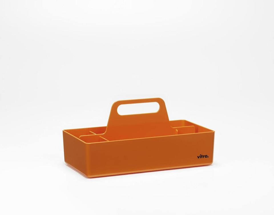 """<p>Portable and practical, this clever caddy speaks to our world of hot desking and flexible working. Though unmistakably utilitarian, its softened edges grant the design a subtle liveability. If orange doesn't do it for you, the evocative colour range also includes 'Mint Green', 'Moss Grey' and 'Sea Blue'. £65, <a href=""""https://www.vitra.com/en-gb/product/toolbox"""" rel=""""nofollow noopener"""" target=""""_blank"""" data-ylk=""""slk:vitra.com"""" class=""""link rapid-noclick-resp"""">vitra.com</a></p>"""