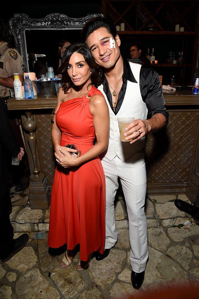"""<p>Take on Tony Manero and Stephanie Mangano from <em>Saturday Night Fever</em> with your best disco ensembles. </p><p><a class=""""link rapid-noclick-resp"""" href=""""https://www.amazon.com/dp/B005FHXM44?tag=syn-yahoo-20&ascsubtag=%5Bartid%7C10070.g.23122163%5Bsrc%7Cyahoo-us"""" rel=""""nofollow noopener"""" target=""""_blank"""" data-ylk=""""slk:SHOP RED DRESS"""">SHOP RED DRESS</a></p><p><a class=""""link rapid-noclick-resp"""" href=""""https://www.amazon.com/California-Costumes-Saturday-Night-Costume/dp/B002ED1KH8?tag=syn-yahoo-20&ascsubtag=%5Bartid%7C10070.g.23122163%5Bsrc%7Cyahoo-us"""" rel=""""nofollow noopener"""" target=""""_blank"""" data-ylk=""""slk:SHOP WHITE SUIT"""">SHOP WHITE SUIT</a></p>"""