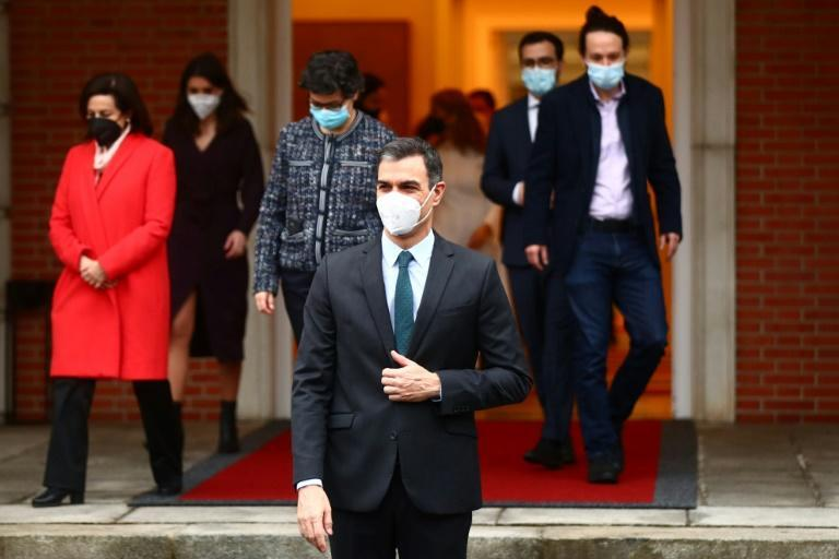 Prime Minister Pedro Sanchez (C) and his ministers arrive for their weekly cabinet meeting in Madrid