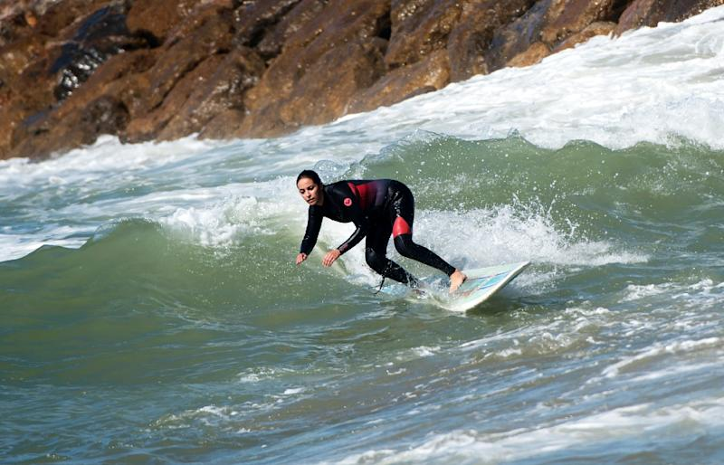 Moroccan women surfers have become increasingly common but some still face prejudice or harassment back on land (AFP Photo/FADEL SENNA)