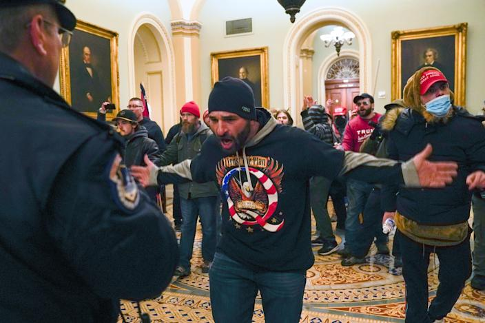 <p>A Capitol rioter wearing QAnon clothing</p> (AP)