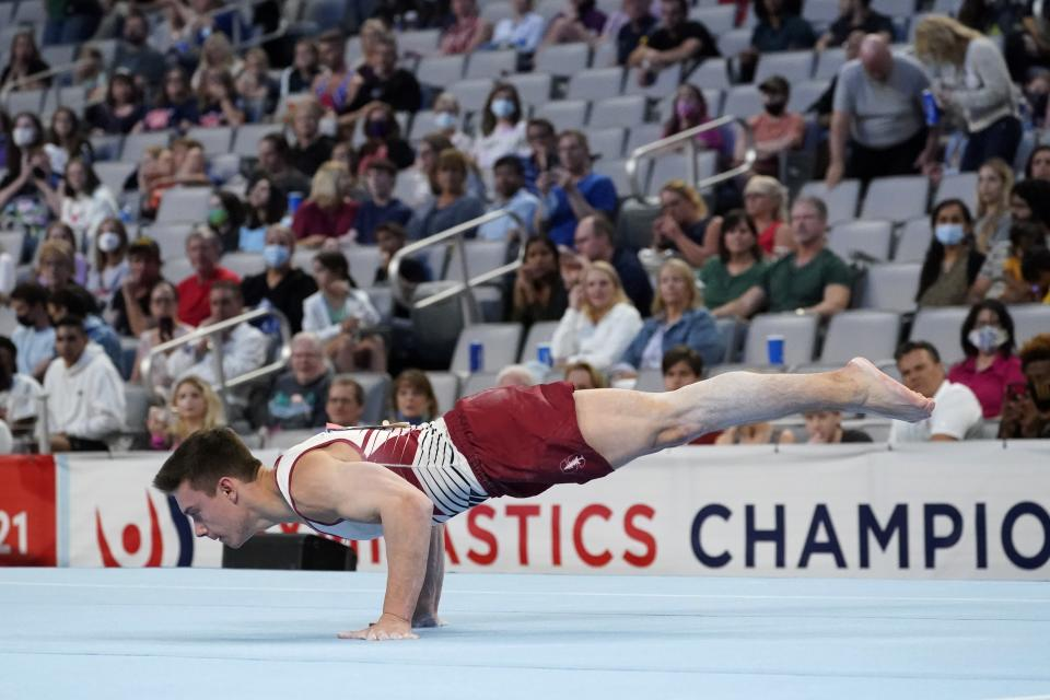Brody Malone competes in the floor exercise during the U.S. Gymnastics Championships, Saturday, June 5, 2021, in Fort Worth, Texas. (AP Photo/Tony Gutierrez)