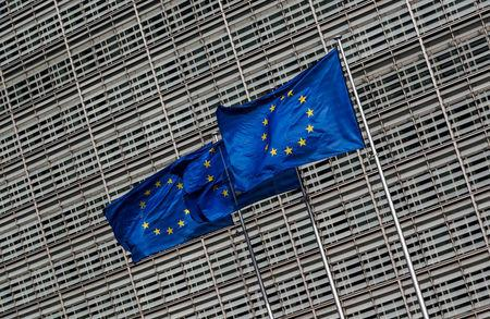 European Union flags flutter outside the EU Commission headquarters in Brussels