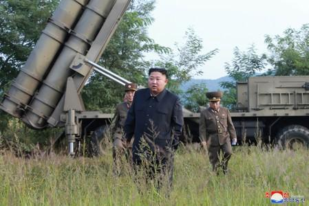 North Korean leader Kim Jong Un attends the testing of a super-large multiple rocket launcher in North Korea