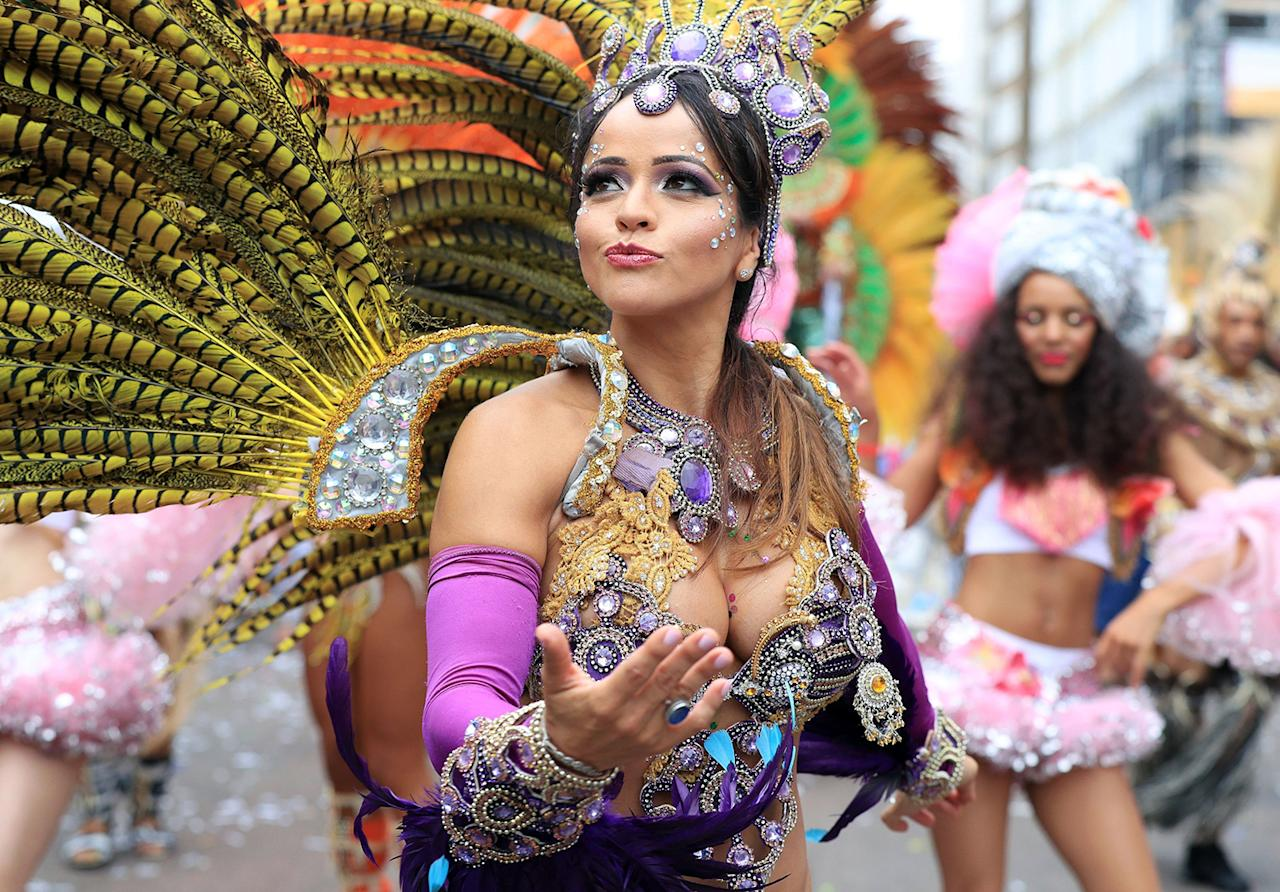 <p>A reveler takes part in the Monday parade, during the second and final day of the Notting Hill Carnival, in London, Monday Aug. 29, 2016. (Jonathan Brady/PA via AP) </p>