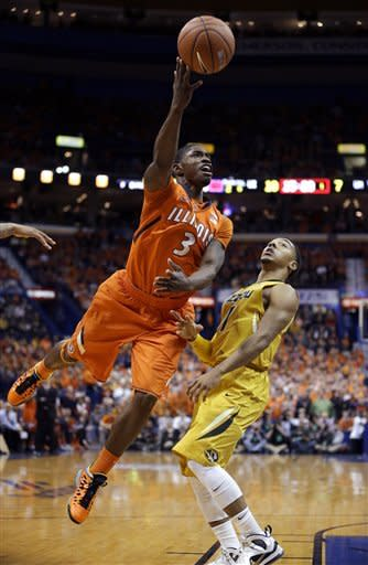 Illinois' Brandon Paul, left, heads to the basket as Missouri's Phil Pressey defends during the first half of an NCAA college basketball game Saturday, Dec. 22, 2012, in St. Louis. (AP Photo/Jeff Roberson)