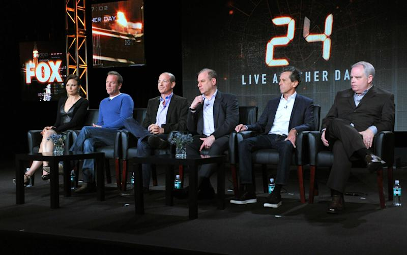 """Mary Lynn Rajskub, from left, Kiefer Sutherland, and executive producers Howard Gordon, Evan Katz, Brian Grazer and Manny Coto attend the panel for """"24: Live Another Day"""" at the FOX Winter 2014 TCA, on Monday, Jan. 13, 2014, at the Langham Hotel in Pasadena, Calif. (Photo by Richard Shotwell/Invision/AP)"""