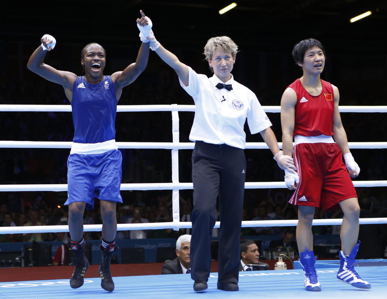 Britain's Nicola Adams (L) reacts as she is declared the winner over China's Ren Cancan during their Women's Fly (51kg) gold medal boxing match at the London Olympic Games August 9, 2012.       REUTERS/Murad Sezer (BRITAIN  - Tags: SPORT BOXING OLYMPICS TPX IMAGES OF THE DAY)