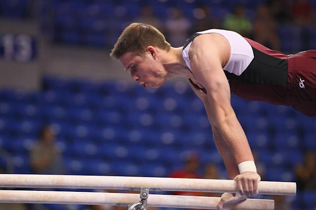 ST. LOUIS, MO - JUNE 7: Alexander Tighe competes in the parallel bars exercise during the Senior Men's competition on day one of the Visa Championships at Chaifetz Arena on June 7, 2012 in St. Louis, Missouri. (Photo by Dilip Vishwanat/Getty Images)