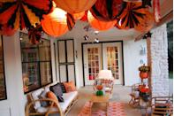"""<p>An array of festive lanterns will create a warm and welcoming effect for guests.</p><p><strong><a href=""""https://www.countryliving.com/home-design/decorating-ideas/g4855/halloween-decorating-ideas-jennifer-perkins/"""" rel=""""nofollow noopener"""" target=""""_blank"""" data-ylk=""""slk:Get the tutorial"""" class=""""link rapid-noclick-resp"""">Get the tutorial</a>.</strong> </p>"""