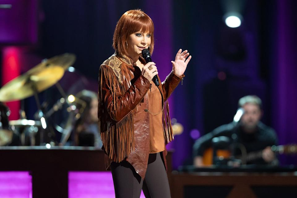 """<p>Reba McEntire rocks a new look on Sept. 13 during Loretta Lynn's Friends: Hometown Rising, held at Nashville's Grand Ole Opry. All proceeds from the charity concert benefit the <a href=""""http://www.unitedwayhumphreys.org/"""" rel=""""nofollow noopener"""" target=""""_blank"""" data-ylk=""""slk:United Way of Humphreys County"""" class=""""link rapid-noclick-resp"""">United Way of Humphreys County</a> to help those affected by <a href=""""https://people.com/human-interest/tennessee-floods-flooding-death-toll-dozens-missing/"""" rel=""""nofollow noopener"""" target=""""_blank"""" data-ylk=""""slk:the historic flooding"""" class=""""link rapid-noclick-resp"""">the historic flooding</a> in the area last month.</p>"""