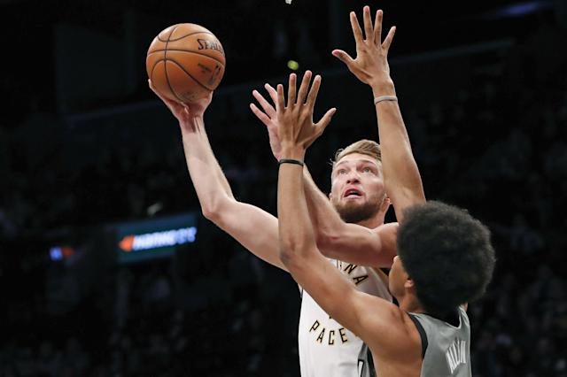 Indiana Pacers forward Domantas Sabonis, left, shoots as Brooklyn Nets center Jarrett Allen, right, defends during the first half of an NBA basketball game, Monday, Nov. 18, 2019, in New York. (AP Photo/Kathy Willens)