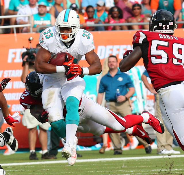 Miami Dolphins running back Daniel Thomas (33) runs for a first down in the second quarter during an NFL football game against the Atlanta Falcons at Sun Life Stadium, Sunday, Sept. 22, 2013, in Miami Gardens, Fla. (AP Photo/El Nuevo Herald, Hector Gabino)