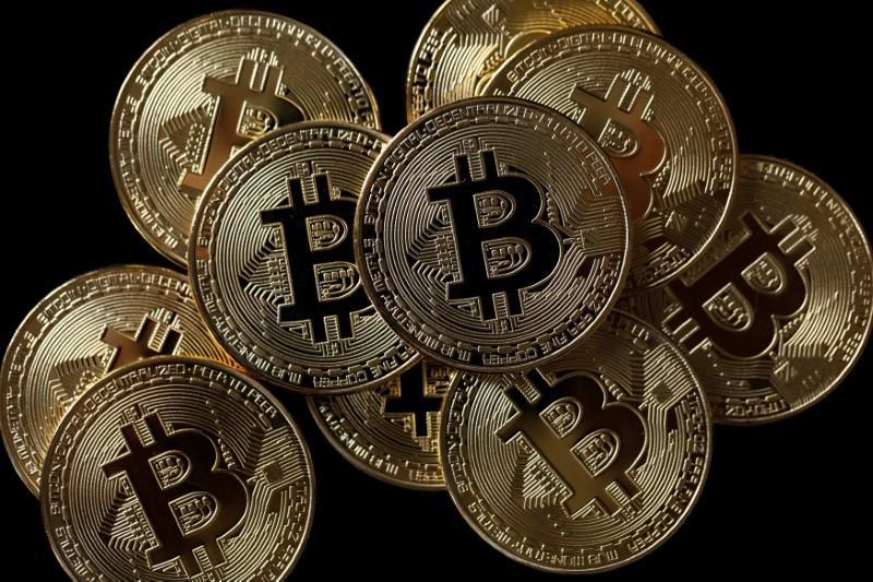 A collection of Bitcoin (virtual currency) tokens are displayed in this picture illustration