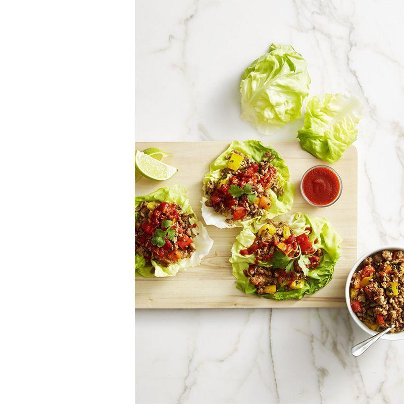"""<p>These healthy turkey lettuce wraps are bursting with flavor, thanks to mint, lime juice, and a healthy serving of Sriracha on top.</p><p><em>Get the recipe from <a href=""""https://www.goodhousekeeping.com/food-recipes/easy/a42833/thai-turkey-lettuce-wraps-recipe/"""" rel=""""nofollow noopener"""" target=""""_blank"""" data-ylk=""""slk:Good Housekeeping"""" class=""""link rapid-noclick-resp"""">Good Housekeeping</a>.</em></p>"""