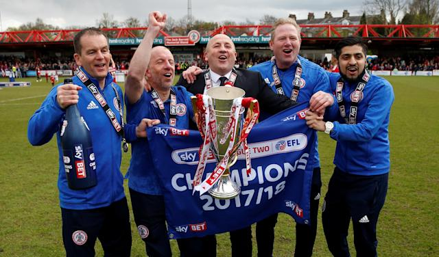 "Soccer Football - League Two - Accrington Stanley v Lincoln City - Wham Stadium, Accrington, Britain - April 28, 2018 Accrington Stanley manager John Coleman and coaching team celebrate with the trophy Action Images/Andrew Boyers EDITORIAL USE ONLY. No use with unauthorized audio, video, data, fixture lists, club/league logos or ""live"" services. Online in-match use limited to 75 images, no video emulation. No use in betting, games or single club/league/player publications. Please contact your account representative for further details."