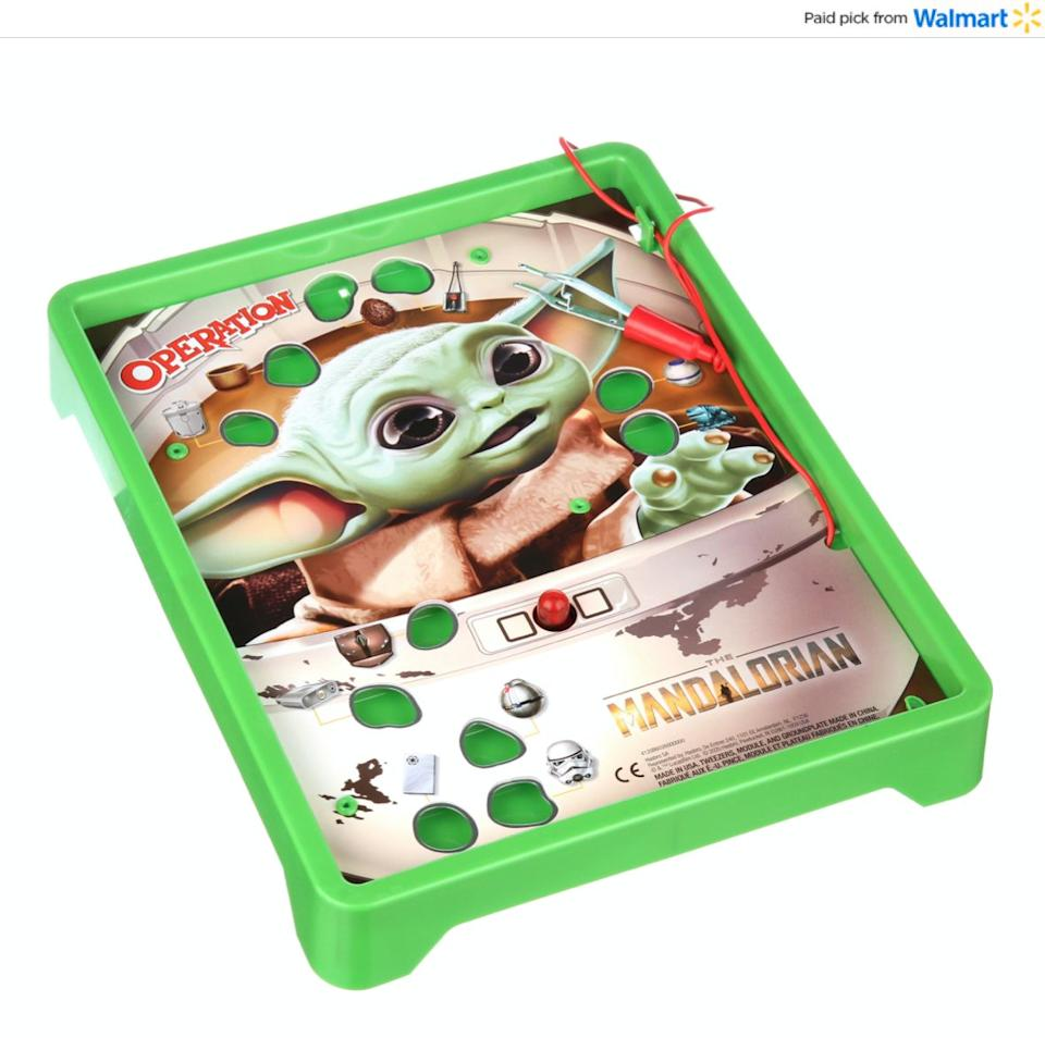 """When it comes to classic games, """"Operation"""" is up there. In this version, kids can take turns trying to get a frog,cup of broth and mudhorn egg with tweezers without setting off a buzzer.<a href=""""https://www.walmart.com/ip/Operation-Game-Star-Wars-The-Mandalorian-Edition-Game/263539418?sourceid=aff_ov_338446cb-ecfc-4727-be8a-820e84f07845&veh=aff&wmlspartner=aff_ov_338446cb-ecfc-4727-be8a-820e84f07845&cn=FY21-Holiday-Gifting_st_hw_aff_nap_ov_snl_oth"""" target=""""_blank"""" rel=""""noopener noreferrer"""">Find it for $16 at Walmart</a>."""