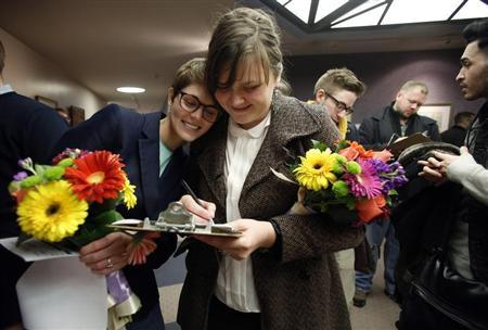 Natalie Dicou and her partner Nicole Christensen wait to get married at the Salt Lake County Clerks office in Salt Lake City, Utah