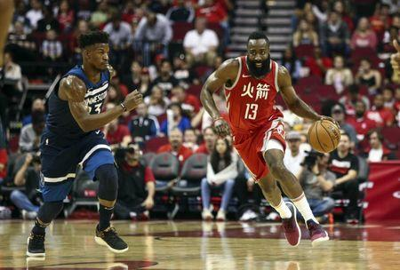 Feb 23, 2018; Houston, TX, USA; Houston Rockets guard James Harden (13) dribbles the ball on a fast break as Minnesota Timberwolves guard Jimmy Butler (23) defends during the first quarter at Toyota Center. Mandatory Credit: Troy Taormina-USA TODAY Sports